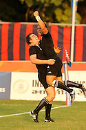 Sherwin Stowers  celebrates the win with Kurt baker during the final of the medal competition of the Rugby Sevens between New Zealand and Australia held at Delhi University as part of the XIX Commonwealth Games in New Delhi, India on the 12 October 2010..Photo by:  Ron Gaunt/photosport.co.nz