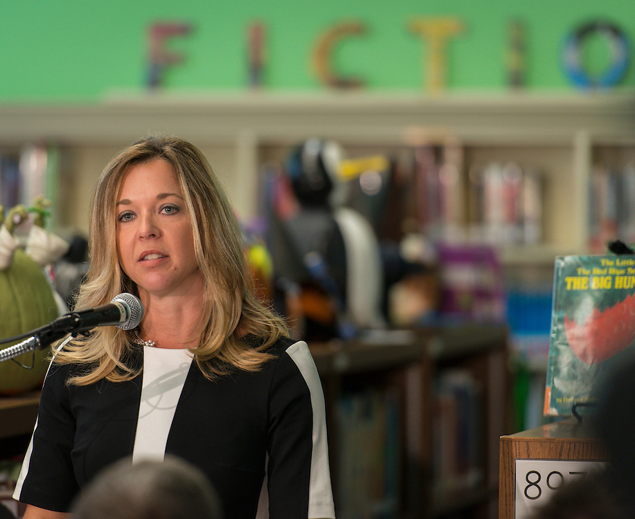 Julie Baker Finck comments during the Read Across the Globe event at Poe Elementary School, October 19, 2015.