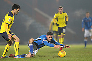 Ian Henderson is fouled during the EFL Sky Bet League 1 match between Rochdale and Oxford United at Spotland, Rochdale, England on 16 December 2017. Photo by Daniel Youngs.