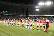 Team Japan celebrate at the end of match during the Japan 2019 Rugby World Cup Pool A match between Japan and Russia at the Tokyo Stadium in Tokyo on September 20, 2019.