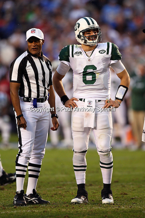 New York Jets quarterback Mark Sanchez (6) smiles as he stands with NFL Referee Jerome Boger (23) while waiting to call time out with 1:09 left in the game prior to a fourth and one play coming up for the Jets during an AFC Divisional Playoff game against the San Diego Chargers, January 17, 2010 in San Diego, California. The Jets won the game 17-14. ©Paul Anthony Spinelli