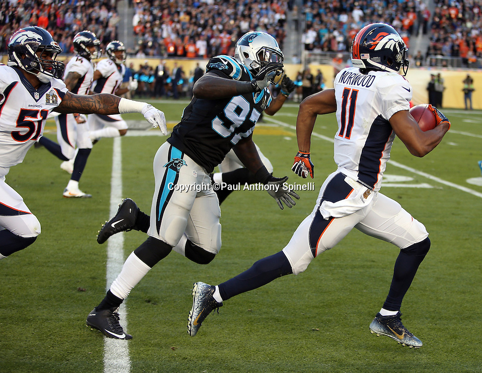 Denver Broncos wide receiver Jordan Norwood (11) is chased by Carolina Panthers defensive end Mario Addison (97) as he returns a second quarter punt for a Super Bowl record 61 yards to the Panthers 14 yard line during the NFL Super Bowl 50 football game against the Carolina Panthers on Sunday, Feb. 7, 2016 in Santa Clara, Calif. The Broncos won the game 24-10. (©Paul Anthony Spinelli)