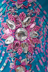 Beads sewn into the material of a traditional Asian dress,