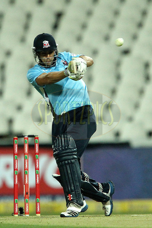Anaru Kitchen attacks a delivery from Rana Naveed during 2nd Qualifying match of the Karbonn Smart CLT20 South Africa between Auckland Aces and Sialkot Stallions held at The Wanderers Stadium in Johannesburg, South Africa on the 9th October 2012..Photo by Ron Gaunt/SPORTZPICS/CLT20