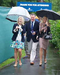 LIVERPOOL, ENGLAND - Friday, June 22, 2012: Spectators brave the torrential rain as they arrive for day two of the Medicash Liverpool International Tennis Tournament at Calderstones Park. (Pic by David Rawcliffe/Propaganda)