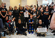 Protesters wearing Believe Women T-shirts marched to stop the confirmation of Judge Brett M. Kavanaugh on Capitol Hill. The day ended with 128 arrests in the Russell Senate Office Building.