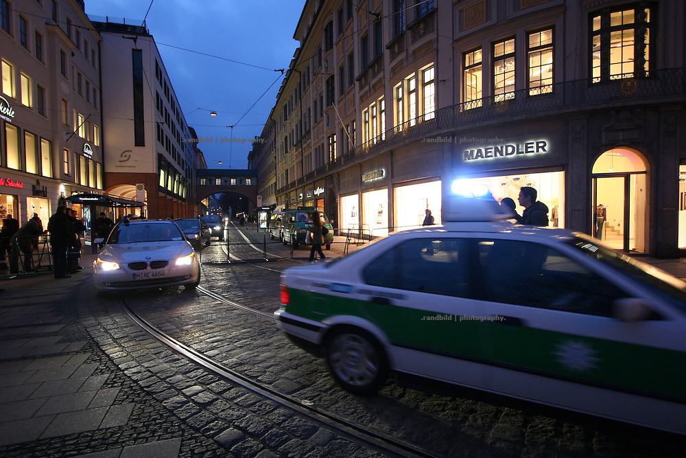 """A convoi of police cars escort limousines of VIP´s of the Security conference. Serveral thousend people demonstrate in Munich against the 45. """"Munich Security Conference"""". They demanded the withdrawal of the troops from Afghanistan and expressed their displeasure about the NATO and its policy."""