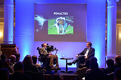 Professor Stephen Hawking reveals the findings of 'A Brief History of How England Can Win The World Cup' a study commissioned by Paddy Power at The Savoy, London, UK.<br /> <br /> Professor Stephen Hawking shows a picture of 'a cow's arse and a banjo' in relation to taking penalties.<br /> <br /> Wednesday, 28th May 2014. Picture by Ben Stevens / i-Images