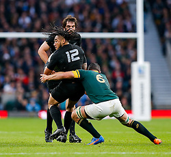 New Zealand Inside Centre Ma'a Nonu is tackled by South Africa Flanker Francois Louw - Mandatory byline: Rogan Thomson/JMP - 07966 386802 - 24/10/2015 - RUGBY UNION - Twickenham Stadium - London, England - South Africa v Wales - Rugby World Cup 2015 Semi Finals.