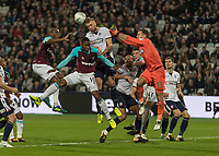 Football - 2017 / 2018 EFL (League) Cup - Third Round: West Ham United vs. Bolton Wanderers<br /> <br /> Mark Beevers (Bolton Wanderers) rises the highest to clear another West Ham cross into the box at the London Stadium.<br /> <br /> <br /> COLORSPORT/DANIEL BEARHAM