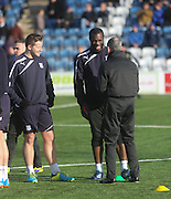 Dundee fitness and conditioning coach Tom Ritchie shares a laugh with Christian Nade - Queen of South v Dundee, SPFL Championship at Palmerston Park <br />