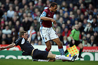 Photo: Rich Eaton.<br /> <br /> Aston Villa v West Ham. The Barclays Premiership. 03/02/2007. John Carew of Aston Villa right gets past Calum Davenport of West Ham