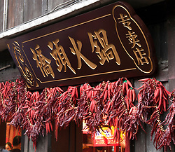 Red peppers decorate the front of a food shop in Ciqikou, an old shopping street/district in Chongqing, China.
