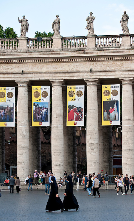 The colonnade of St. Peter's Basilica features banners from the pontificate of Pope John Paul II. The banners were hung for the beatification of Blessed John Paul. (Sam Lucero photo)
