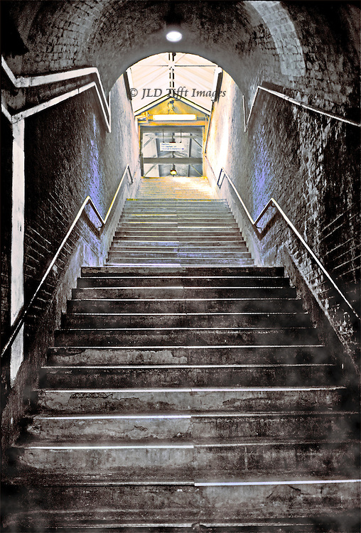 London: Earlsfield Train station, stairway to the platform, 2003, before remodelling in 2006. The original brick walls give off mystical lights in blue, pink, and yellow, in reflecting the sunlight from the platform above.