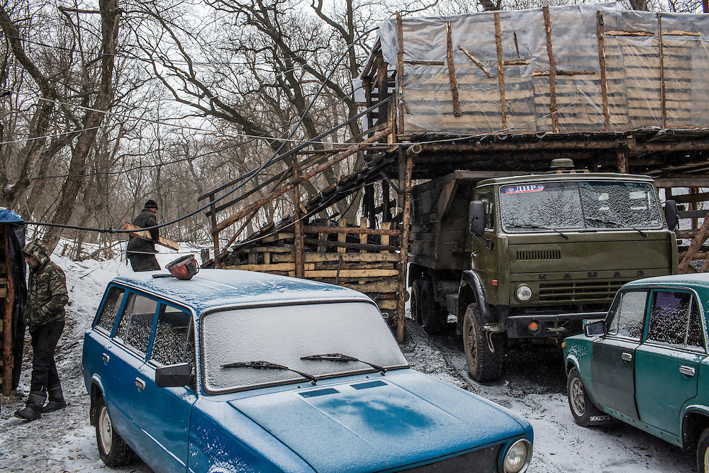 SNEZHNE, UKRAINE - JANUARY 25, 2015: A  small private coal mine in the woods in Snezhne, Ukraine. The mine produces approximately 15 tons of coal per day with a crew of four men. CREDIT: Brendan Hoffman for The New York Times