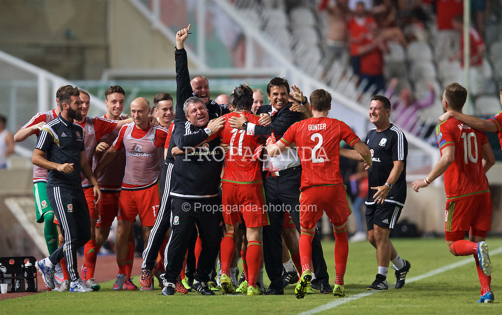 NICOSIA, CYPRUS - Thursday, September 3, 2015: Wales' match-winning goal scorer Gareth Bale celebrates the 1-0 victory over Cyprus with manager Chris Coleman and assistant manager Osian Roberts during the UEFA Euro 2016 qualifying match at the GPS Stadium. (Pic by David Rawcliffe/Propaganda)