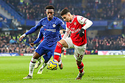 Chelsea midfielder Callum Hudson-Odoi (20) tussles with Arsenal forward Gabriel Martinelli (35) during the Premier League match between Chelsea and Arsenal at Stamford Bridge, London, England on 21 January 2020.