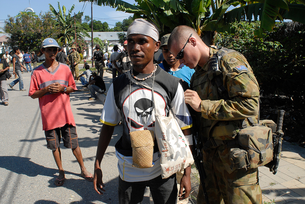 Australian soldiers search suspected gang members for weapons near the Comora area of Dili, a hot point for clashes between rival gangs, the ( Lorosae) and the Westerners (Loromonu). Much of the violence is tat for tat revenge for the lotting and burning of homes. 05/06/06 East Timor