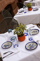 FOOD Food sidewalk cafe restaurant table linen table cloth napkin plates silverware glasses plant romance romantic evening out