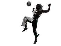 one black man soccer player juggling football on white background