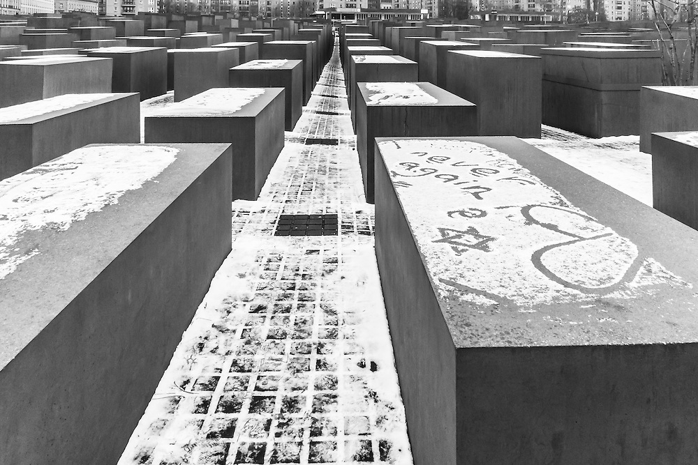 """The words """"never again"""" can be seen written in the snow at the Memorial to the Murdered Jews of Europe in Berlin, Germany"""
