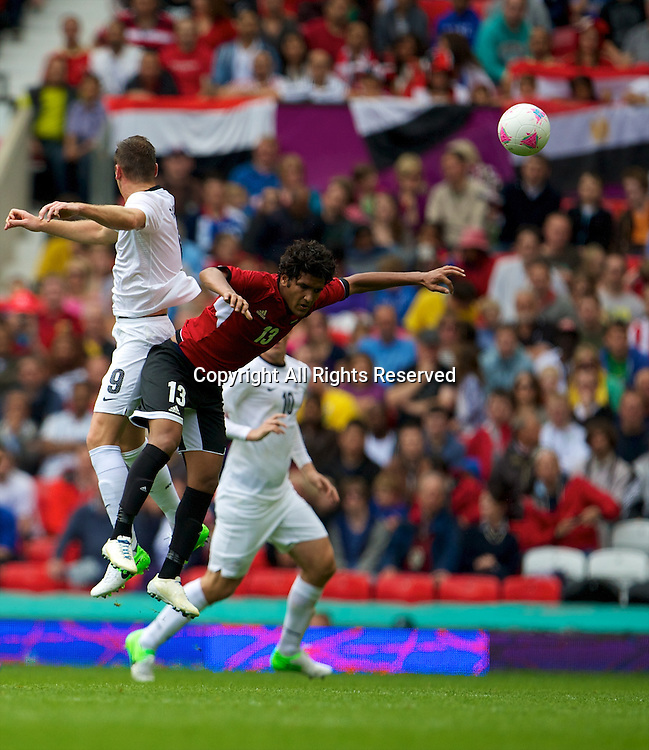 29.07.2012 Manchester, England. Egypt midfielder Saleh Gomaa and New Zealand forward Shane Smeltz in action during the first round group C mens match between Egypt and New Zealand.