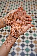 Henna desgins decorating a young woman's hands, Meknes, Morocco.