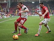 Billy Sharp (Sheffield United) holds off Chris Stokes (Coventry City) and Jacob Murphy (Coventry City) during the Sky Bet League 1 match between Sheffield Utd and Coventry City at Bramall Lane, Sheffield, England on 13 December 2015. Photo by Mark P Doherty.