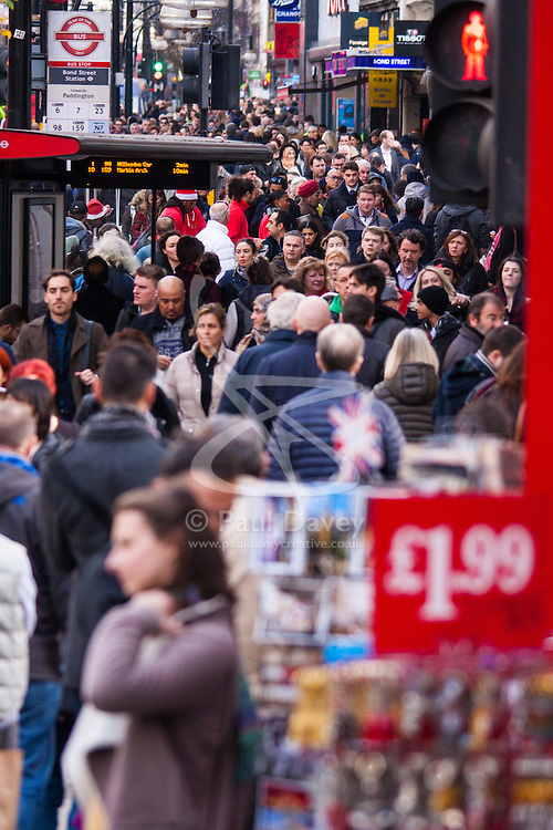 """London, December 23rd 2014. Dubbed by retailers as the """"Golden Hour"""" thousands of shoppers use their lunch hour to do some last minute Christmas shopping in London's West End. PICTURED: Oxford Steets pavements are crammed with shoppers on their lunch break."""