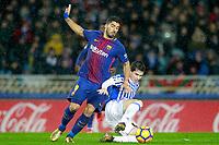 Real Sociedad's Igor Zubeldia (r) and FC Barcelona's Luis Suarez during La Liga match. January 14,2018. (ALTERPHOTOS/Acero)