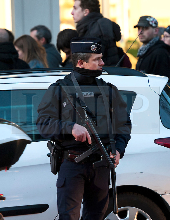 """© London News Pictures. 16/02/2015 Olympia Theatre, Paris: A heavy police precedes as the Eagles of Death Metal """"resume their gig"""" three months after the terrorist attack at Bataclan that claimed the lives of 90 people on 13 November 2015. Heavy security was in evidence and media kept at a distance """"to preserve the dignity of returning survivors"""" according to a police spokesperson. Ticket holders of the fateful Bataclan concert were offered complimentary tickets for tonight's gig. Photo credit: Guilhem Baker/LNP"""