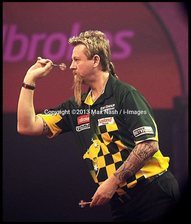 Australia's Simon Whitlock during his world darts semi finals match against Britain's Peter Wright at Alexandra palace, london, United Kingdom. Monday, 30th December 2013. Picture by Max Nash / i-Images