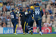 Andrew Salter and Glamorgan celebrate the wicket of Colin Munro during the Vitality T20 Blast South Group match between Hampshire County Cricket Club and Glamorgan County Cricket Club at the Ageas Bowl, Southampton, United Kingdom on 6 July 2018. Picture by Dave Vokes.