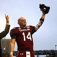 South Carolina Gamecocks quarterback Connor Shaw (14) celebrates winning the MVP award after the NCAA Capital One Bowl football game between the South Carolina Gamecocks who represent the SEC and the Wisconsin Badgers who represent the Big 10 Conference, at the Florida Citrus Bowl on Wednesday, January 1, 2014 in Orlando, Florida.   South Carolina won the game 34-24. (AP Photo/Alex Menendez)
