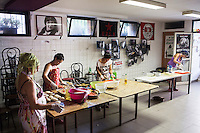 """ROME, ITALY - 3 JULY 2016: (L-R) Gipsy Queens members Codruta Balteau (24), Darmaz Florentina (33), Maria Miglescu (20) and Aninfa Hokic (31) prepare typical Roma dishes for their food stand at the iFest, an alternative music festival, here in the Astra 19 social center in Rome, Italy, on July 3rd 2016.<br /> <br /> The Gipsy Queens are a travelling catering business founded by Roma women in Rome.<br /> <br /> In 2015 Arci Solidarietà, an independent association for the promotion of social development, launched the """"Tavolo delle donne rom"""" (Round table of Roma women) to both incentivise the process of integration of Roma in the city of Rome and to strengthen the Roma women's self-esteem in the context of a culture tied to patriarchal models. The """"Gipsy Queens"""" project was founded by ten Roma women in July 2015 after an event organised together with Arci Solidarietà in the Candoni Roma camp in the Magliana, a neighbourhood in the South-West periphery of Rome, during which people were invited to dance and eat Roma cuisine. The goal of the Gipsy Queen travelling catering business is to support equal opportunities and female entrepreneurship among Roma women, who are often relegated to the roles of wives and mothers."""