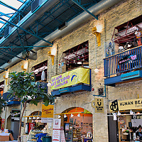 The Forks Market Courtyard in Winnipeg, Canada<br /> The Forks Market is filled with delightful shopping boutiques, specialty food stalls and restaurants plus galleries that sell the works from about 300 local artists. Also inside is the Travel Manitoba Visitor Information Centre. Their staff was instrumental in helping me plan my photographic journey encircling Winnipeg. The canopy over this courtyard connects two former horse stalls. They were used by the Grand Trunk Pacific Railway and the Great Northern Railway in the early 1900s.