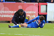 AFC Wimbledon defender George Francomb (7) down injured during the EFL Sky Bet League 1 match between AFC Wimbledon and Peterborough United at the Cherry Red Records Stadium, Kingston, England on 17 April 2017. Photo by Matthew Redman.