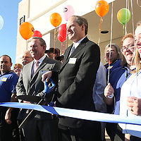 Adam Robison | BUY AT PHOTOS.DJOURNAL.COM<br /> Michael Storey, Store Manager at Kroger on Main Street, cuts the ribbon for the grand reopening Wednesday morning in Tupelo.
