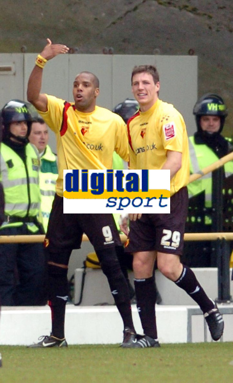 Photo: Leigh Quinnell.<br /> Watford v Luton Town. Coca Cola Championship. 09/04/2006. Watfords Darius Henderson helps Marlon King(L) celebrate his goal.