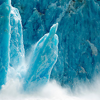 USA, Alaska, Tracy Arm - Fjords Terror Wilderness, Huge column of ice calves from collapsing face of Dawes Glacier
