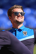 AFC Wimbledon midfielder Jake Reeves (8) smiling and enjoying  the sun during the EFL Sky Bet League 1 match between AFC Wimbledon and Bristol Rovers at the Cherry Red Records Stadium, Kingston, England on 8 April 2017. Photo by Matthew Redman.