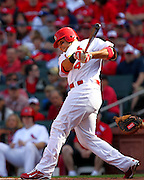 17 April 2010: St. Louis Cardinals catcher Yadier Molina (4) watches after hitting a ball into the outfield during Saturday's game against the New York Mets at Busch Stadium in St. Louis, Missouri. The Game would go 20 innings, with the Mets winning 2-1.