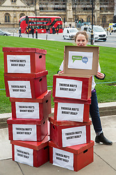 "London, UK. 14th January, 2019. 'Deal or No Deal' boxes reading ""Theresa May's Brexit deal?"" on the outside and ""People's Vote"" on the inside brought by activists from People's Vote UK to Parliament Square. A vote on Prime Minister Theresa May's proposed Brexit withdrawal agreement is due to be held in the House of Commons on 15th January."