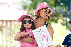 In the pink, a young fan waits for the race to arrive at Giro Rosa 2018 - Stage 2, a 120.4 km road race starting and finishing in Ovada, Italy on July 7, 2018. Photo by Sean Robinson/velofocus.com