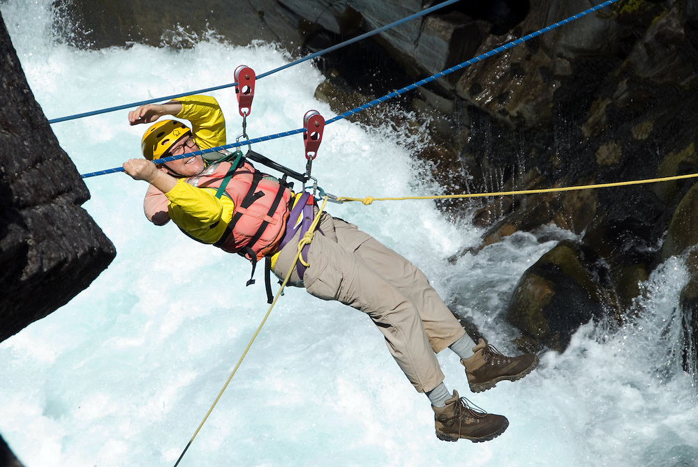 Tyrolian traverse across Zeta Rapid on the Futaleufu River in Chile.