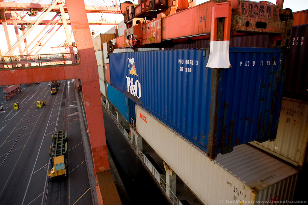A container is offloaded from a cargo ship by a ship-to-shore crane where it will be placed on a waiting SSA Marine tractor trailer, called a hustler, at Terminal 18 at the Port of Seattle. The diesel fueled hustler will soon be running biodiesel, a more environmentally friendly alternative fuel produced from oilseed crops.