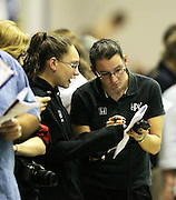 Swimming coaches discuss times with their swimmers.2011 New Zealand Short Course Championships, Day 1, Wellington Aquatics Centre, Kilbirnie, Wellington, Saturday 6 August 2011. Photo: Justin Arthur / photosport.co.nz