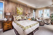 Neutral Tones Master Bedroom with a Wood Paneling Accent Wall Stock Photo