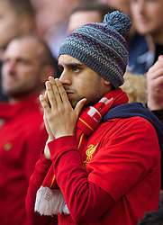 27.04.2014, Anfield, Liverpool, ENG, Premier League, FC Liverpool vs FC Chelsea, 36. Runde, im Bild A Liverpool supporter looks dejected as his side are beaten 2-0 by an ultra defensive Chelsea team // during the English Premier League 36th round match between Liverpool FC and Chelsea FC at Anfield in Liverpool, Great Britain on 2014/04/27. EXPA Pictures © 2014, PhotoCredit: EXPA/ Propagandaphoto/ David Rawcliffe<br /> <br /> *****ATTENTION - OUT of ENG, GBR*****